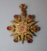 A late Victorian ruby and seed pearl brooch cum pendant, the six point star set with circular cut