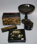 A late 19th century Japanese black lacquer brush box, typically chinoiserie decorated with figures