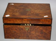A Victorian walnut writing slope with single well fitted interior. Bears plaque for Parkins and