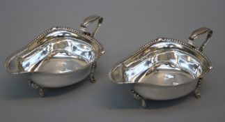 Edward Barnard and sons Ltd., a pair of Geo.V silver sauce boats each of shallow trefoli form with