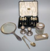 A collection of silver topped,glass dressing table jars. Together with a pair of squat silver