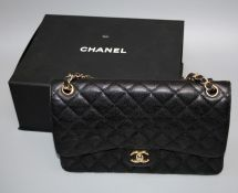 A Chanel-style Jumbo double flap bag with 'gold hardware', boxed.