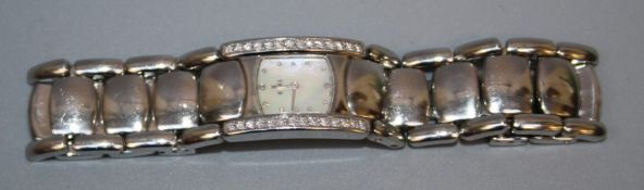 A ladies Ebel Beluga diamond set stainless steel wristwatch, the rounded rectangular dial with