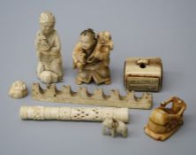 A Chinese possibly Ming dynasty carved ivory scholars pen rest on mountain range form together