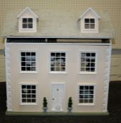 A late 20th century doll's house, fashioned as a three storey Georgian town house, containing a good