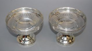 Asprey and Co. Ltd., a pair of Geo.V silver pedestal bon bon dishes, each with pierced bowl, conical