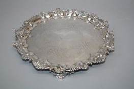 A Victorian silver salver engraved with daiper reserves around stag coronet crest within a scalloped