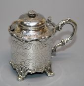 John Evans II, a silver cylindrical mustard with domed hinged cover, leaf capped scroll handle and
