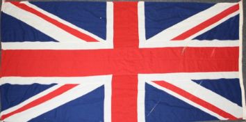 A mid 20th century cotton Union Flag. 125 x 260 cms.