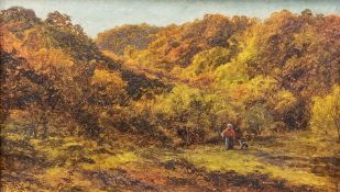 George Turner (British, 1843-1910), a wooded landscape with a figure and a dog, signed l.r., oil