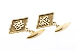 A pair of 18ct gold cufflinks, diamond form with applied Chinese lettering, chain and bar