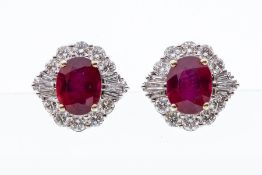 A pair of ruby and diamond 18ct white gold cluster earrings, comprising central claw set rubies,