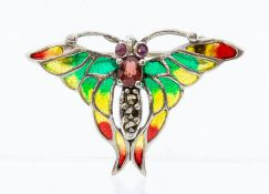 A silver and plique a jour brooch in the form of a small butterfly, the body set with ruby and