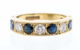 A sapphire and diamond 18ct gold ring, comprising a row of alternate round cut sapphires and