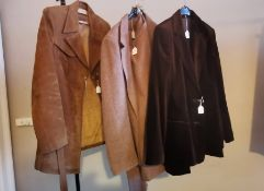 A 1970s ladies brown leather and sheep's wool lined coat, a size 14 wool tweed type ladies suit,