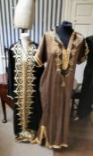 From the wardrobe of Opera singer Jessye Norman. striped gold and deep blue kaftan with a braided