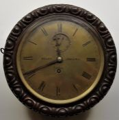 A scarce mid 19th century circular Marine oak cased wall clock, the brass dial with Roman numeral