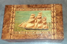 A large folk art interest writing slope with marquetry sailing ship and original fitted