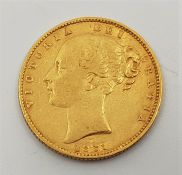 """An 1861 Victoria """"Young bust"""" gold sovereign,rev. shield."""