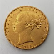 """An 1863 Victoria """"Young bust"""" gold sovereign,rev. shield."""