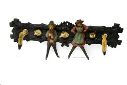 Black Forest work Coat and hat hooks, Carved and painted wood, horns and hooves, decorated with
