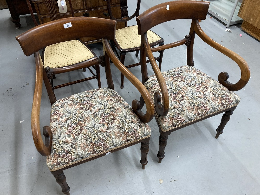 Early 19th cent. Mahogany bar back armchairs on sabre supports at the back and tapering supports