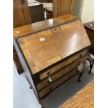 20th cent. Mahogany drop front inlaid bureau on cabriole supports.