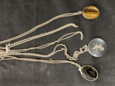 Hallmarked Silver: Necklets, two twisted rope lines, the other three with pendants, one being a