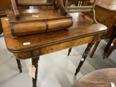 19th cent. Mahogany fold over tea table on turned supports.
