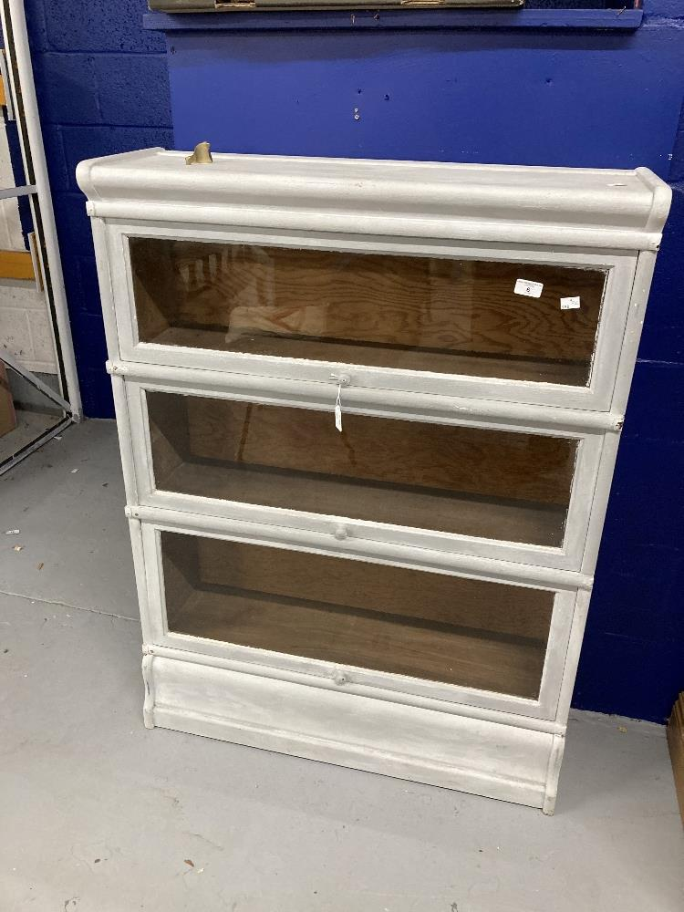 20th cent. Painted white Globe Wernecke style glass fronted bookcase with three shelves. Height