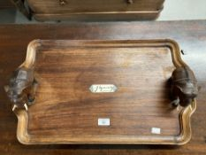 Late 19th/early 20th cent. Hardwood tray decorated with elephants. Inset ebony/ivory panel bearing