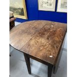 19th cent. Yew drop leaf dining table on tapered supports, eight plank. 75ins. x 45ins. x 28ins.