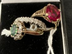 Hallmarked Gold: 9ct. Gold, three rings one set with a synthetic emerald and synthetic white