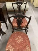 Late 19th/early 20th cent. pair of ebonised mahogany nursing chairs with pierced slat backs.