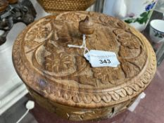 20th cent. Oriental circular carved box, leaf and floral decoration, with plain finial. 9ins. Dia.