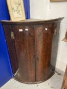 Early 19th cent. Georgian oak with inlay bow fronted wall hung corner cupboard with two integral