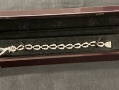 Hallmarked Gold: 18ct. White gold oval link bracelet set with one hundred and forty five brilliant