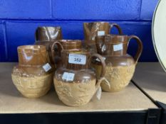 Doulton Lambeth: Stoneware harvest jugs. Six graduated jugs. Two A/F. From 5ins. to 8¼ins.