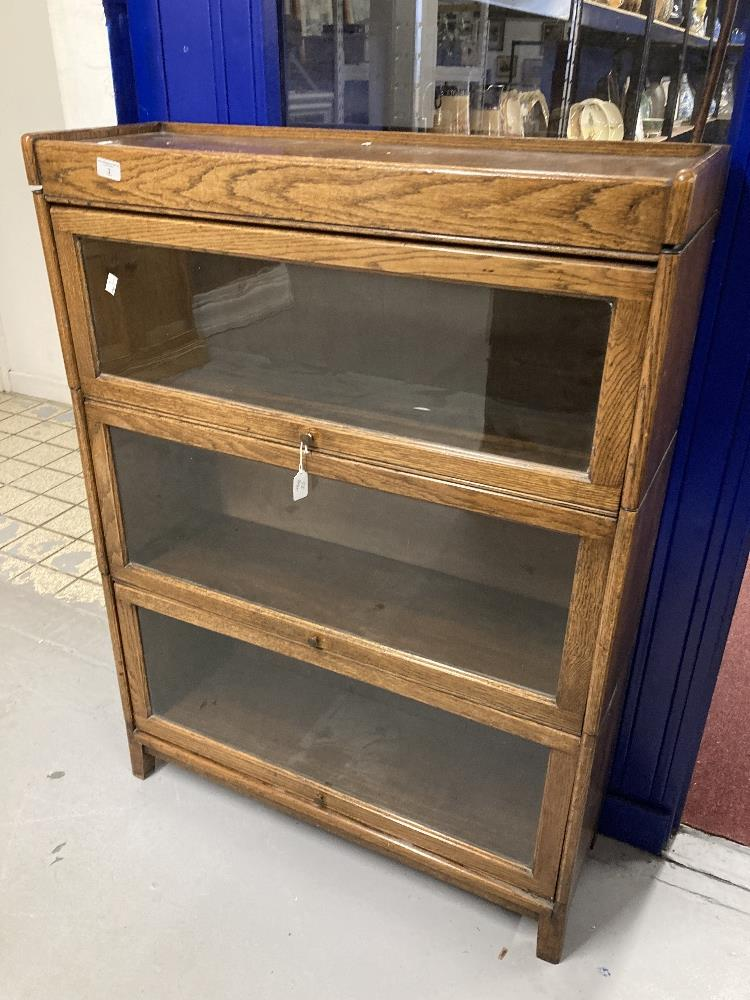 20th cent. Oak Globe Wernecke style glass fronted bookcase with three shelves. Height 46ins. Width