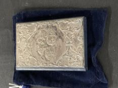 Hallmarked Silver: Notelet book with repousse front depicting Putti, leather body & velvet case,