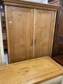 20th cent. Stripped pine wardrobe with drawer.