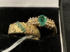Jewellery: Two yellow metal rings, one set with an oval cut emerald with six brilliant cut