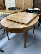 19th cent. Biedermeier style birch oval dining table with one leaf, on tapered supports. 55ins. x