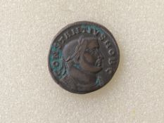 Roman Follis AE Constantinius bust facing right as Caesar 301-303 mint mark PLG (Lyon) Genio Pop uli