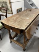 18th/19th cent. Oak drop leaf, gate leg dining table with later additions, on gun barrel supports