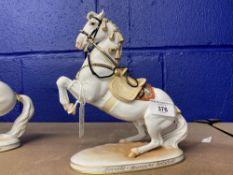 20th cent. Ceramics: Augarten Spanish riding school figurine 'Leuade' riderless rearing horse.