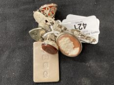 Hallmarked Silver: Nine silver items to include fobs, brooches, padlock fasteners and ingot.
