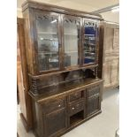 Art Nouveau: Stained pine glazed dresser. 60ins. x 84ins. x 18ins.