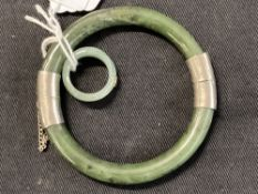 Jewellery: Oriental Chinese jade bangle with silver fittings and a jade ring as a entwined band with