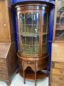 Early 20th cent. Mahogany bow fronted, Regency revival glazed display cabinet, over one drawer & two